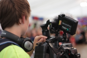 a crew member filmming at one of the events